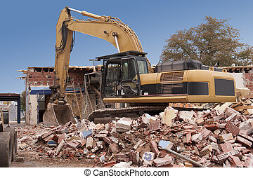 Building Demolition - A large backhoe demolishes an old...