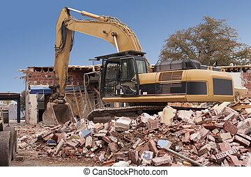 Building Demolition - A large backhoe demolishes an old...