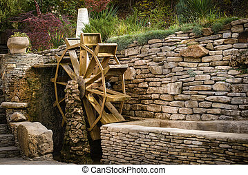 Water wheel - Decorative wooden water wheel in the park