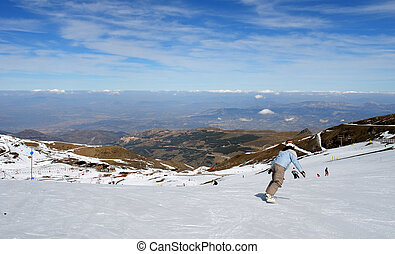 Snowboarder, in sierra nevada resort track (Spain)...
