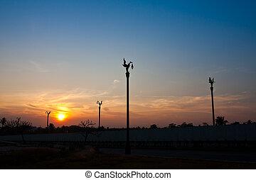 Streetlamp and sunset sky