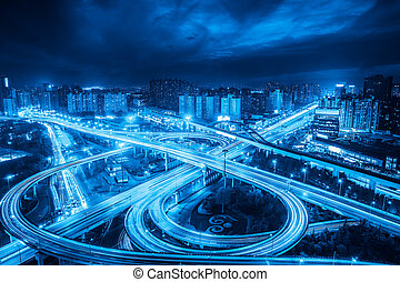 city interchange overpass at night in shanghai ,blue tone