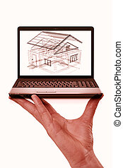Laptop with Picture of House in human hand