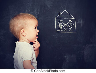 Concept baby looks at board, which is drawn family and home...