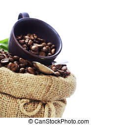 Coffee beans in burlap sack over white