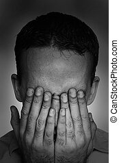 Clinical Depression - Closeup view of a young man suffering...