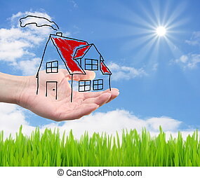dream house - hand hold a house on a landscape