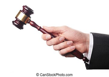 auctioneer - an auctioneers hand is holding a wooden gavel