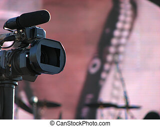 Video camera - The lens of a video camera on pink background...