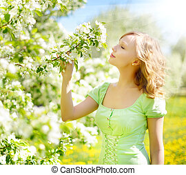 Blossoming apple tree - Young girl near the apple tree....