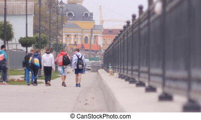 young people walking - group of young people walking along...