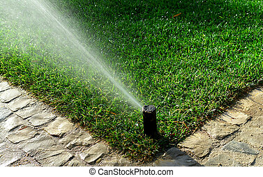 Garden irrigation system watering lawn...