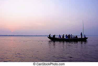 Boat trip in ganjes river at sunrise - boat trip in ganjes...