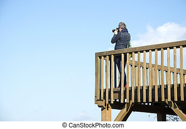 adult woman with camera