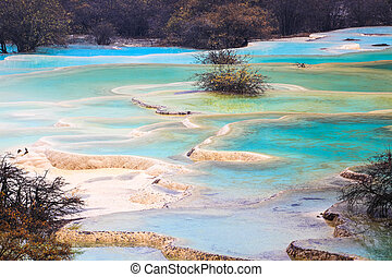 beautiful travertine ponds in autumn at huanglong scenic and...