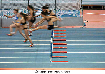 women race - indoors women 60 meters low hurdlers race in...