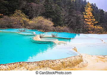 blue travertine ponds in huanglong, sichuan, China