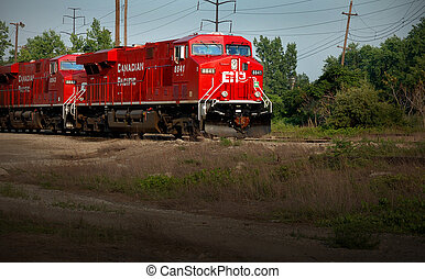 Rairoad Locomotive - Train engines pulling trains out of...