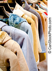 Stack of casual coat on hangers - female coat clothes...