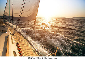 Yacht sailing during sunset. Luxury yachts.