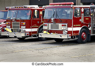 Fire Trucks Close-up - Local fire department red engines on...