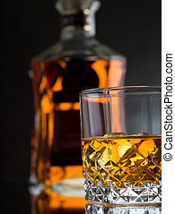 Whisky on the rocks - Glass of whisky on the rocks with a...