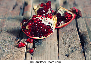 Pomegranate - Photo of ripe pomegranate on wooden background