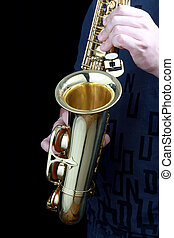 sax - golden alto saxophone in hands of young man
