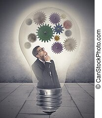 Idea - Businessman thinking about new idea inside a lamp