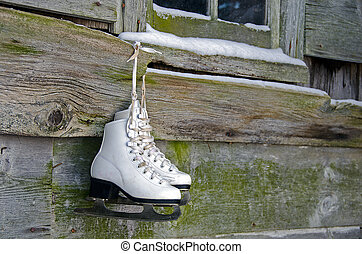 hanging ice skates - Ice skates hanging from old barn window...