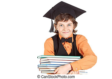 stack books - Smart schoolboy in academic hat holding a...
