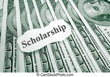 Scholarship money - Scholarship text on paper, over hundred...