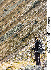 Active women on mountain path - Tatras Mountains. Polish...