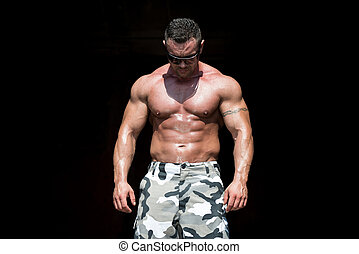 Body Builder Posing - Handsome Man Isolated On Black...