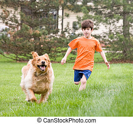 Boy Running With Dog - Young Boy Racing Dog