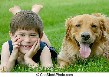 Little Boy Laying with Dog