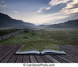 Creative concept pages of book View along countryside fields towards misty Snowdonia mountain range in distance