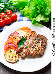 Steak with grilled vegetables on a plate - Delicious steak...