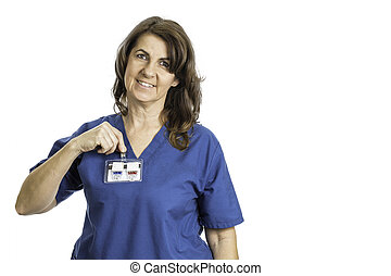 Woman Radiology Student Putting on Her Badge - A female...