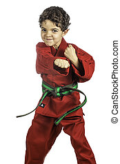 Young Boy in a Red Karate Uniform - A young boy dressed in a...