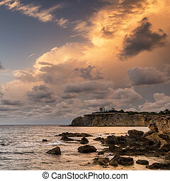 Dawn sunrise landscape over beautiful rocky coastline in...