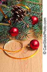 Christmas design - Christmas fir, red bauble and ribbon on...