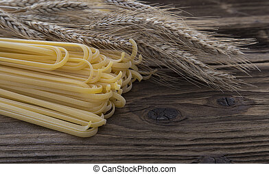 Bundle of long spaghetti on a old grungy wooden desk