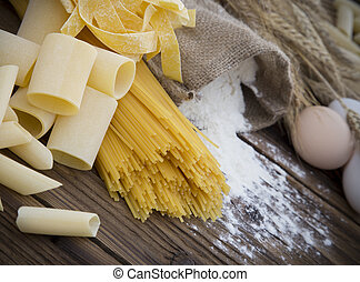 Assortment of uncooked pasta - Close up on assortment of...