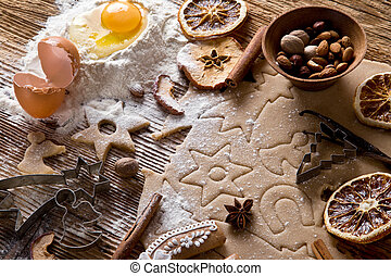 Baking utensils, spices and food ingredients on wooden...