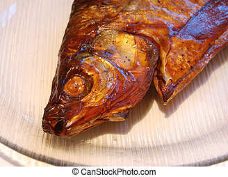 fish - head of a bronzy smoked white-fish on the plate