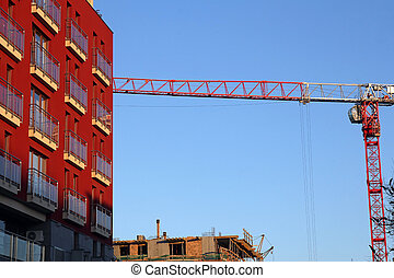apartment house and house under constuction with crane