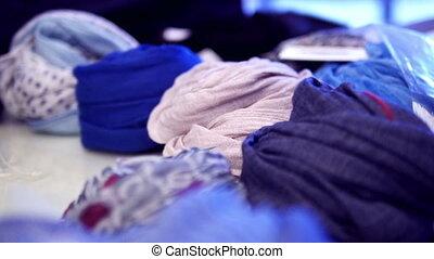 scarfs at fashion boutique - HD 1080p - Close up tilt view...