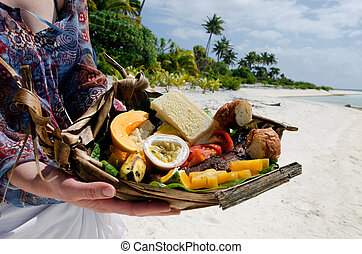 Tropical food on deserted tropical island - Young woman...