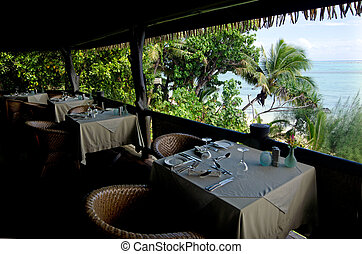 Table for two in tropical pacific ocean Island.